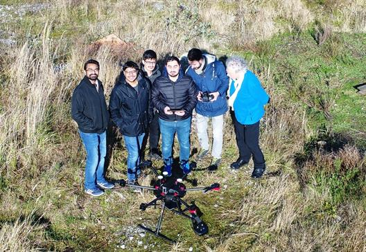 The Erasmus students watching a UAS, photographed from a bird's eye perspective by another UAS